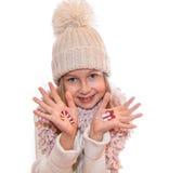 Boîte de cadeau de Noël et sucette de Noël peinte sur la main de l'enfant Image stock