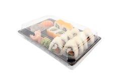 Boîte de la livraison de sushi sur le fond blanc Menu du Japon dans la boîte noire de transport Photographie stock