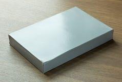 Boîte de papier grise vide photographie stock