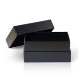 Boîte de papier noire d'isolement sur le blanc Images stock