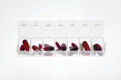 Boîte de pilule avec la variété de pilules Image libre de droits
