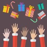Boîte de Santa Hands With Christmas Gift Photos stock