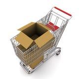 Boîte en carton dans le chariot Photographie stock