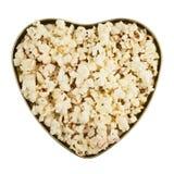 Boîte en forme de coeur complètement de maïs éclaté Image stock