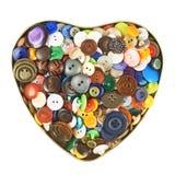 Boîte en forme de coeur remplie de boutons Photo libre de droits