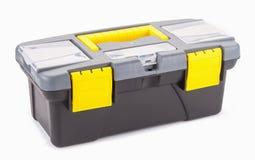 Boîte en plastique avec des outils d'isolement sur le fond blanc images libres de droits