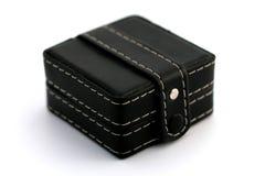 Boîte noire avec l'horloge à l'intérieur Photos stock