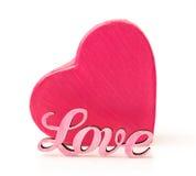 Boîte rose dans la forme de coeur avec amour de mot Images stock