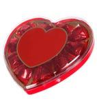 Boîte rouge de coeur de chocolats Image stock