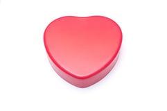 Boîte rouge de forme de coeur d'isolement Photo stock