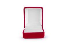 Boîte rouge de velours d'isolement sur le fond blanc Image libre de droits