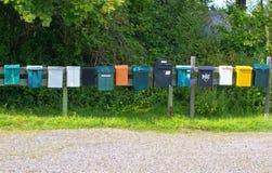 Boîtes aux lettres dans une rangée Photographie stock libre de droits