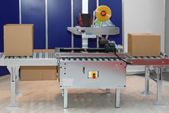 Boîtes d'emballage de machine Photographie stock