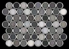 Boîtes de la peinture dans diverses nuances de gris image stock