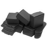 Boîtes de papier noires pliables D'isolement Photographie stock