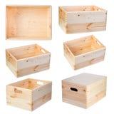 Boîtes en bois d'isolement sur le fond blanc Photographie stock libre de droits