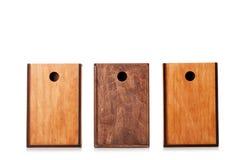 Boîtes en bois d'isolement sur un fond blanc Trois caisses de bois naturel pour la conservation ou le stockage de expédition Copi Photographie stock libre de droits