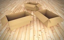 Boîtes en carton vides sur l'étage Photographie stock