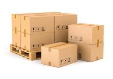 Boîtes et palette en carton Photo stock