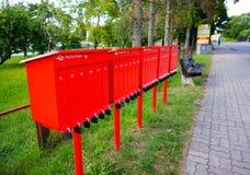 Boîtes rouges de courrier Photographie stock