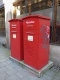 Boîtes rouges de courrier Photos stock