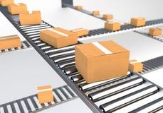Boîtes sur la bande de conveyeur Photographie stock libre de droits