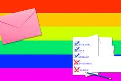 Boîtes vérifiées avec l'inscription sur le drapeau LGBT d'arc-en-ciel photographie stock libre de droits