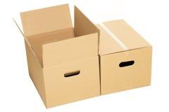 Boîtes vides et fermées sur le fond blanc Photos libres de droits