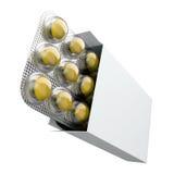 Boîtier blanc rempli de pilules jaunes dans la boursouflure Image stock