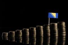 Bośnia i Herzegovina zaznaczamy z udziałem monety odizolowywać na czerni zdjęcia stock