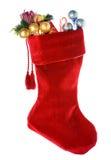 Boże Narodzenia: Czerwona Bożenarodzeniowa pończocha z dekoracjami Obraz Stock