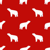 boże narodzenia deseniują bezszwowego Niedźwiedź polarny na czerwonym tle Zdjęcie Royalty Free