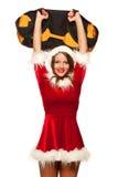 Boże Narodzenia, mas, zima, szczęścia pojęcie - Bodybuilding Silna dysponowana kobieta ćwiczy z worek z piaskiem w Santa pomagier Fotografia Stock