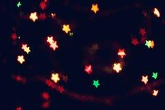 Boże Narodzenia, nowego roku tło z pięknym gwiazdy bokeh kolorowa girlanda zaświecają Zdjęcia Stock