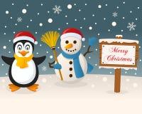Boże Narodzenia Podpisują pingwinu & Ślicznego bałwanu - Zdjęcie Royalty Free