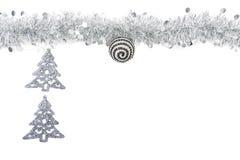 Boże Narodzenia siwieją srebną girlandę z srebnymi drzewami na białym tle Zdjęcie Royalty Free