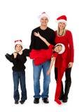 Boże Narodzenia: Wakacyjna rodzina Podtrzymywał małej dziewczynki zdjęcia stock