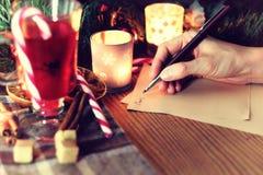 Boże Narodzenie ręki writing opowieść Zdjęcie Royalty Free