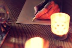 Boże Narodzenie ręki writing opowieść Obraz Royalty Free