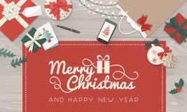 Boże Narodzenie stół z prezentami i życzenia royalty ilustracja