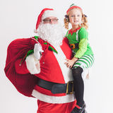 Bożego Narodzenia życzenie 2016 claus dziewczyna mały Santa Mówić życzenia Zdjęcia Royalty Free