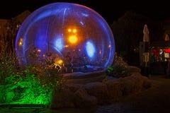 Bożenarodzeniowa śnieżna kula ziemska w którym fletowy gracz Fotografia Stock