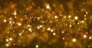 Bożenarodzeniowa cyfrowa błyskotliwość iskrzy złotego cząsteczki bokeh spływanie na złocistym tle, wakacje xmas świąteczny szczęś zdjęcie wideo
