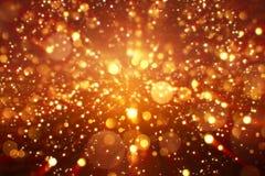 Bożenarodzeniowa cyfrowa błyskotliwość iskrzy złotego cząsteczki bokeh wybuch na czarnym tle obrazy royalty free