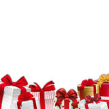 Bożenarodzeniowa dekoraci granica prezentów pudełka z czerwonymi faborkami - rama - Fotografia Stock
