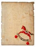 Bożenarodzeniowa dekoracja kołysa koń zabawkę z starzejącą się papierową stroną Fotografia Royalty Free