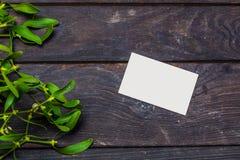 Bożenarodzeniowa dekoracja z papierową kartą Zdjęcie Royalty Free