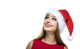 Bożenarodzeniowa szczęśliwa kobieta w Santa czerwieni kapeluszu Obrazy Royalty Free