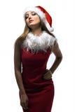 Bożenarodzeniowa szczęśliwa kobieta w Santa czerwieni kapeluszu Zdjęcia Royalty Free