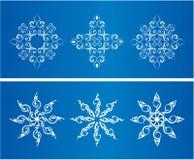Bożenarodzeniowa sztuka. Na błękitny tle biały płatek śniegu Zdjęcia Royalty Free